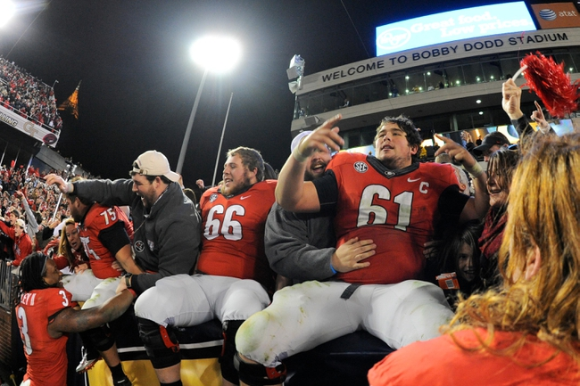 Nov 30, 2013; Atlanta, GA, USA; Georgia Bulldogs players center Hunter Long (66) and center David Andrews (61) celebrate with their fans after defeating the Georgia Tech Yellow Jackets at Bobby Dodd Stadium. Georgia defeated Georgia Tech 41-34 in overtime. Mandatory Credit: Dale Zanine-USA TODAY Sports