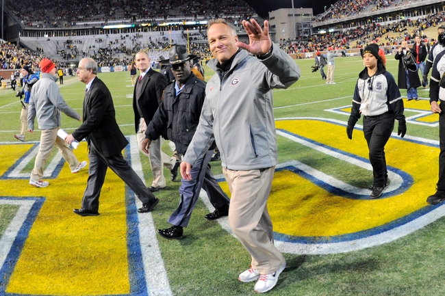Nov 30, 2013; Atlanta, GA, USA; Georgia Bulldogs head coach Mark Richt  waves to the fans on his way off the field after defeating the Georgia Tech Yellow Jackets at Bobby Dodd Stadium. Georgia defeated Georgia Tech 41-34 in overtime. Mandatory Credit: Dale Zanine-USA TODAY Sports
