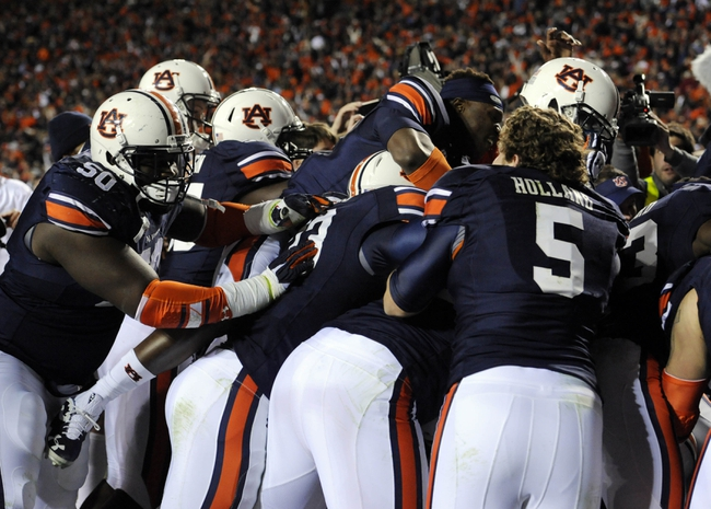 Nov 30, 2013; Auburn, AL, USA; Then Auburn Tigers celebrate after defeating the Alabama Crimson Tide at Jordan Hare Stadium. Auburn Tigers won 34-28. Mandatory Credit: Shanna Lockwood-USA TODAY Sports
