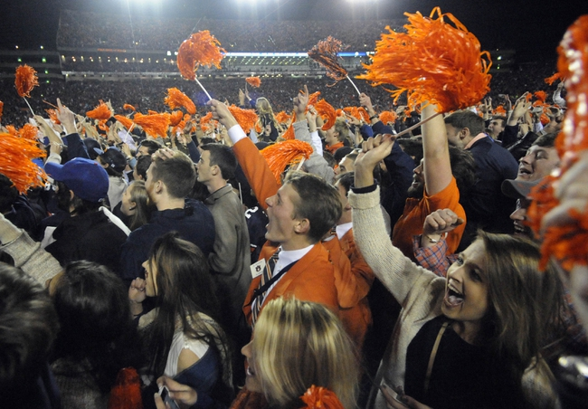 Nov 30, 2013; Auburn, AL, USA; Auburn Tigers fans celebrate on the field after defeating the Alabama Crimson Tide at Jordan Hare Stadium. Auburn Tigers won 34-28. Mandatory Credit: Shanna Lockwood-USA TODAY Sports