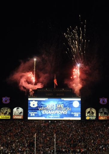 Nov 30, 2013; Auburn, AL, USA; Fireworks and the scoreboard after the Auburn Tigers defeated the Alabama Crimson Tide to clinch the SEC West at Jordan Hare Stadium. Auburn Tigers won 34-28. Mandatory Credit: Shanna Lockwood-USA TODAY Sports