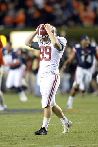 Nov 30, 2013; Auburn, AL, USA; Alabama Crimson Tide kicker Adam Griffith (99) reacts after missing a 57 yard field goal that was returned for a touchdown during the fourth quarter at Jordan Hare Stadium. Auburn Tigers won 34-28. Mandatory Credit: John David Mercer-USA TODAY Sports