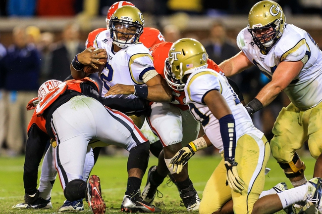 Nov 30, 2013; Atlanta, GA, USA; Georgia Tech Yellow Jackets quarterback Vad Lee (2) is tackled for a loss by Georgia Bulldogs linebacker Leonard Floyd (84) in overtime at Bobby Dodd Stadium. Georgia won 41-34 in overtime. Mandatory Credit: Daniel Shirey-USA TODAY Sports