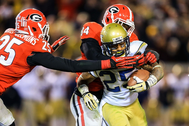 Nov 30, 2013; Atlanta, GA, USA; Georgia Bulldogs linebacker Leonard Floyd (84) and safety Josh Harvey-Clemons (25) tackle Georgia Tech Yellow Jackets running back Robert Godhigh (25) for a loss to force a fourth down in overtime  at Bobby Dodd Stadium. Georgia won 41-34 in overtime. Mandatory Credit: Daniel Shirey-USA TODAY Sports