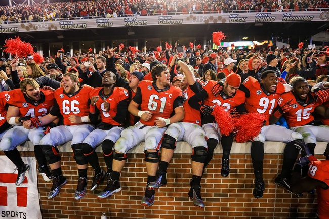 Nov 30, 2013; Atlanta, GA, USA; The Georgia Bulldogs celebrate with fans after beating the Georgia Tech Yellow Jackets at Bobby Dodd Stadium. Georgia won 41-34 in overtime. Mandatory Credit: Daniel Shirey-USA TODAY Sports