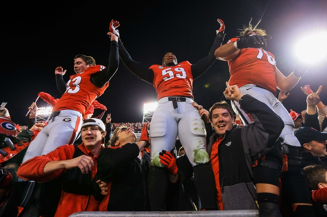 Nov 30, 2013; Atlanta, GA, USA; Georgia Bulldogs linebacker Jordan Jenkins (59), nose tackle Chris Mayes (93) and offensive tackle Zach DeBell (76) celebrate after beating the Georgia Tech Yellow Jackets at Bobby Dodd Stadium. Georgia won 41-34 in overtime. Mandatory Credit: Daniel Shirey-USA TODAY Sports