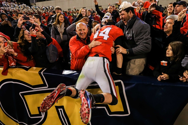 Nov 30, 2013; Atlanta, GA, USA; Georgia Bulldogs quarterback Hutson Mason (14) celebrates with fans after beating the Georgia Tech Yellow Jackets at Bobby Dodd Stadium. Georgia won 41-34 in overtime. Mandatory Credit: Daniel Shirey-USA TODAY Sports