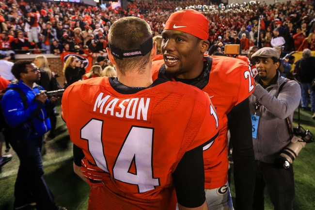 Nov 30, 2013; Atlanta, GA, USA; Georgia Bulldogs safety Josh Harvey-Clemons (25) celebrates with quarterback Hutson Mason (14) after beating the Georgia Tech Yellow Jackets at Bobby Dodd Stadium. Georgia won 41-34 in overtime. Mandatory Credit: Daniel Shirey-USA TODAY Sports
