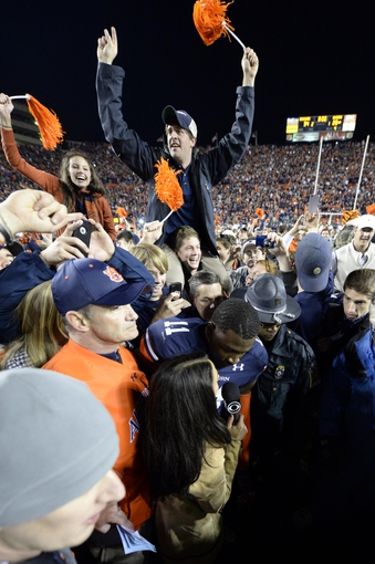 Nov 30, 2013; Auburn, AL, USA; Auburn Tigers cornerback Chris Davis (11) is interviewed after defeating the Alabama Crimson Tide at Jordan Hare Stadium. Auburn Tigers won 34-28. Mandatory Credit: John David Mercer-USA TODAY Sports