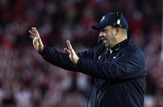 Nov 30, 2013; Madison, WI, USA; Penn State Nittany Lions head coach Bill O'Brien directs his team during the game with the Wisconsin Badgers at Camp Randall Stadium. Penn State defeated Wisconsin 31-24. Mandatory Credit: Mary Langenfeld-USA TODAY Sports