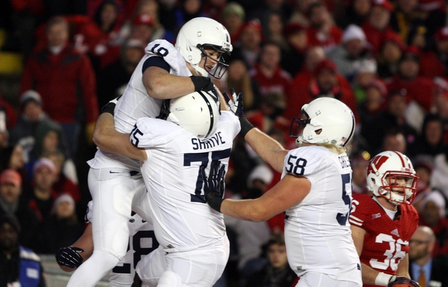 Nov 30, 2013; Madison, WI, USA; Penn State Nittany Lions tight end Jesse James (18) celebrates his touchdown with guard Eric Shrive (75) and tackle Adam Gress (58) at Camp Randall Stadium. Penn State defeated Wisconsin 31-24. Mandatory Credit: Mary Langenfeld-USA TODAY Sports