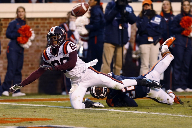 Nov 30, 2013; Charlottesville, VA, USA; Virginia Cavaliers cornerback DreQuan Hoskey (22) interferes with Virginia Tech Hokies wide receiver Demitri Knowles (80) as he attempts to catch the ball in the end zone in the fourth quarter at Scott Stadium. The Hokies won 16-6. Mandatory Credit: Geoff Burke-USA TODAY Sports