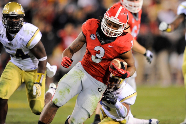 Nov 30, 2013; Atlanta, GA, USA; Georgia Bulldogs running back Todd Gurley (3) runs against the Georgia Tech Yellow Jackets during overtime at Bobby Dodd Stadium. Georgia defeated Georgia Tech 41-34 in overtime. Mandatory Credit: Dale Zanine-USA TODAY Sports