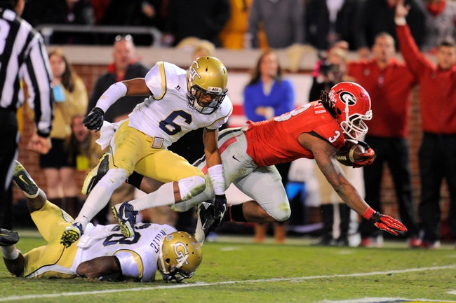 Nov 30, 2013; Atlanta, GA, USA; Georgia Bulldogs running back Todd Gurley (3) scores a touchdown past Georgia Tech Yellow Jackets defensive back Chris Milton (6) during overtime at Bobby Dodd Stadium. Georgia defeated Georgia Tech 41-34 in overtime. Mandatory Credit: Dale Zanine-USA TODAY Sports