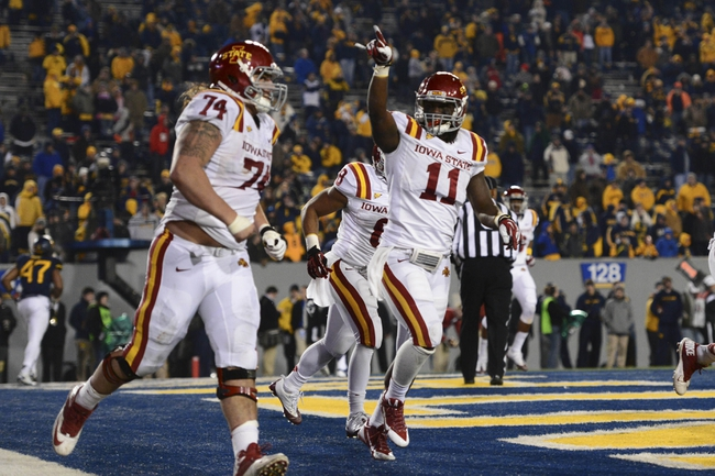 Nov 30, 2013; Morgantown, WV, USA; Iowa State Cyclones tight end E.J. Bibbs (11) point to the crowd after catching a two-point coverage during the third overtime  at Milan Puskar Stadium. Iowa State Cyclones defeated West Virginia Mountaineers 52-44 in the third overtime. Mandatory Credit: Tommy Gilligan-USA TODAY Sports