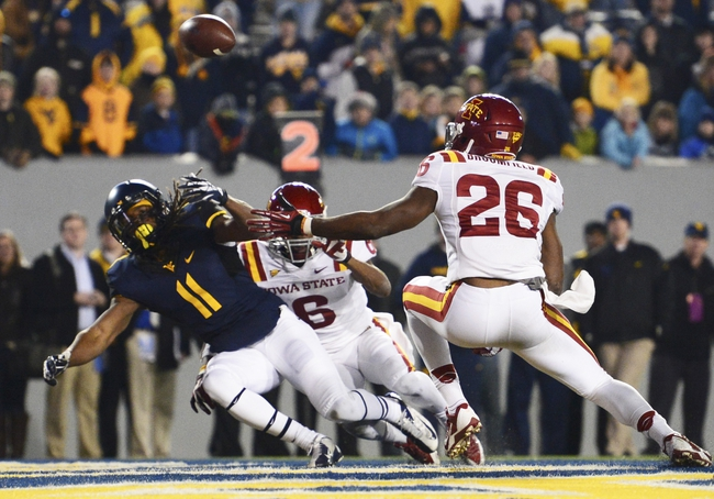 Nov 30, 2013; Morgantown, WV, USA; Iowa State Cyclones defensive back Kenneth Lynn (6) and  defensive back Deon Broomfield (26) break up the intended pass to West Virginia Mountaineers wide receiver Kevin White (11) during the third overtime  at Milan Puskar Stadium. Iowa State Cyclones defeated West Virginia Mountaineers 52-44 in the third overtime. Mandatory Credit: Tommy Gilligan-USA TODAY Sports