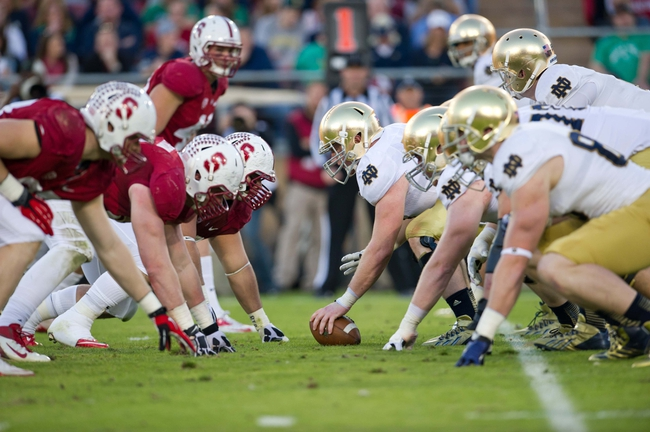 Nov 30, 2013; Stanford, CA, USA; Notre Dame Fighting Irish center Matt Hegarty (77) prepares to snap the ball in the second quarter against the Stanford Cardinal at Stanford Stadium. Mandatory Credit: Matt Cashore-USA TODAY Sports