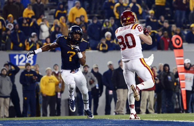 Nov 30, 2013; Morgantown, WV, USA; Iowa State Cyclones wide receiver Justin Coleman (80) catches a pass for a touchdown in the third overtime at Milan Puskar Stadium. Iowa State Cyclones defeated West Virginia Mountaineers 52-44 in the third overtime. Mandatory Credit: Tommy Gilligan-USA TODAY Sports