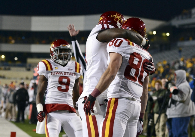Nov 30, 2013; Morgantown, WV, USA; Iowa State Cyclones wide receiver Justin Coleman (80) celebrates with teammates after scoring a touchdown in the fourth quarter that sent the game into overtime at Milan Puskar Stadium. Iowa State Cyclones defeated West Virginia Mountaineers 52-44 in the third overtime. Mandatory Credit: Tommy Gilligan-USA TODAY Sports