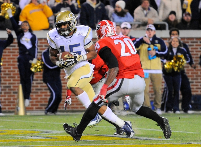 Nov 30, 2013; Atlanta, GA, USA; Georgia Tech Yellow Jackets wide receiver DeAndre Smelter (15) catches a touchdown behind Georgia Bulldogs defensive back Quincy Mauger (20) during the second half at Bobby Dodd Stadium. Georgia defeated Georgia Tech 41-34 in overtime. Mandatory Credit: Dale Zanine-USA TODAY Sports