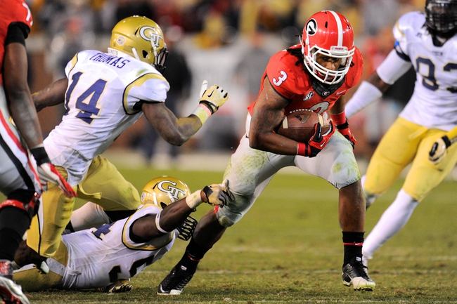 Nov 30, 2013; Atlanta, GA, USA; Georgia Bulldogs running back Todd Gurley (3) breaks a tackle by Georgia Tech Yellow Jackets linebacker Quayshawn Nealy (54) during the second half at Bobby Dodd Stadium. Georgia defeated Georgia Tech 41-34 in overtime. Mandatory Credit: Dale Zanine-USA TODAY Sports