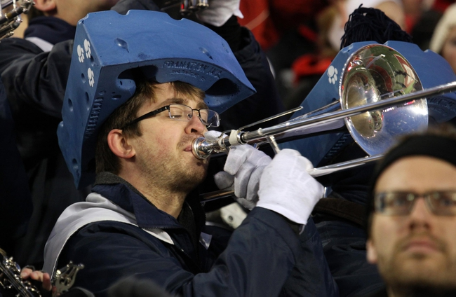 Nov 30, 2013; Madison, WI, USA; A Penn State Nittany Lions band member wears a blue cheese head hat as his team plays the Wisconsin Badgers at Camp Randall Stadium. Penn State defeated Wisconsin 31-24. Mandatory Credit: Mary Langenfeld-USA TODAY Sports
