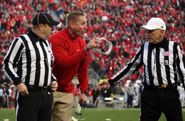 Nov 30, 2013; Madison, WI, USA; Wisconsin Badgers head coach Gary Andersen reacts near the end of the first half as his team plays the Penn State Nittany Lions at Camp Randall Stadium. Penn State defeated Wisconsin 31-24. Mandatory Credit: Mary Langenfeld-USA TODAY Sports