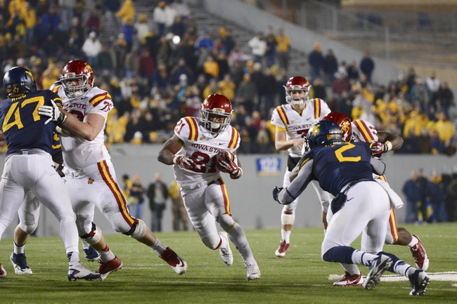 Nov 30, 2013; Morgantown, WV, USA; Iowa State Cyclones running back Shontrelle Johnson (20) runs with the ball during overtime  at Milan Puskar Stadium. Iowa State Cyclones defeated West Virginia Mountaineers 52-44 in the third overtime. Mandatory Credit: Tommy Gilligan-USA TODAY Sports