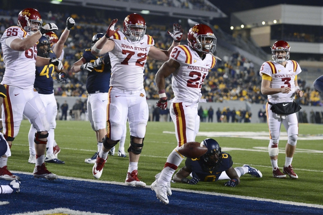 Nov 30, 2013; Morgantown, WV, USA; Iowa State Cyclones running back Shontrelle Johnson (21) celebrates with teammates after scoring a touchdown in the fourth quarter against the West Virginia Mountaineers at Milan Puskar Stadium. Iowa State Cyclones defeated West Virginia Mountaineers 52-44 in the third overtime. Mandatory Credit: Tommy Gilligan-USA TODAY Sports