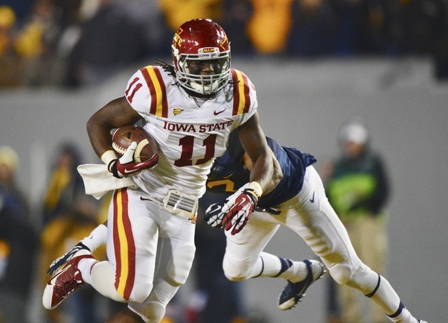 Nov 30, 2013; Morgantown, WV, USA; Iowa State Cyclones tight end E.J. Bibbs (11) runs past West Virginia Mountaineers linebacker Isaiah Bruce (31) with the ball during the second half at Milan Puskar Stadium. Iowa State Cyclones defeated West Virginia Mountaineers 52-44 in the third overtime. Mandatory Credit: Tommy Gilligan-USA TODAY Sports