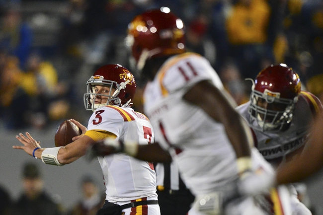 Nov 30, 2013; Morgantown, WV, USA; Iowa State Cyclones quarterback Grant Rohach (3) throws the ball to Iowa State Cyclones tight end E.J. Bibbs (11) during the second half  at Milan Puskar Stadium. Iowa State Cyclones defeated West Virginia Mountaineers 52-44 in the third overtime. Mandatory Credit: Tommy Gilligan-USA TODAY Sports
