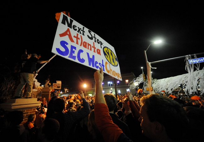 Nov 30, 2013; Auburn, AL, USA; A fan holds up a sign at Toomer's Corner after the game between the Alabama Crimson Tide and the Auburn Tigers at Jordan Hare Stadium. The Tigers defeated the Crimson Tide 34-28. Mandatory Credit: Shanna Lockwood-USA TODAY Sports
