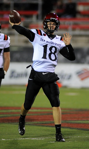 Nov 30, 2013; Las Vegas, NV, USA; San Diego State Aztecs quarterback Quinn Kaehler (18) throws the ball during warmups before an NCAA football game against the UNLV Rebels at Sam Boyd Stadium. Mandatory Credit: Stephen R. Sylvanie-USA TODAY Sports