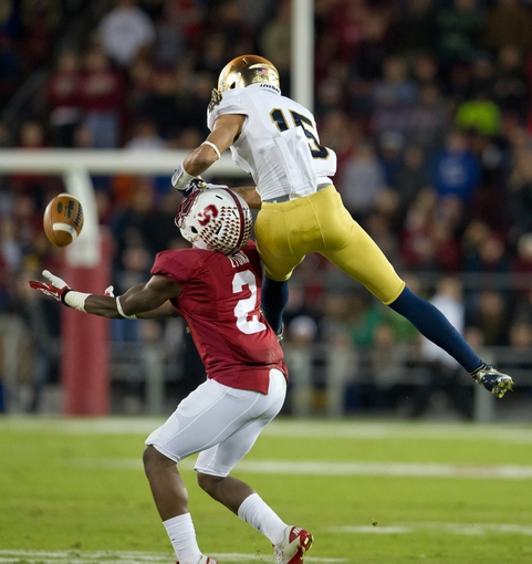 Nov 30, 2013; Stanford, CA, USA; Stanford Cardinal cornerback Wayne Lyons (2) intercepts a pass intended for Notre Dame Fighting Irish wide receiver William Fuller (15) in the fourth quarter at Stanford Stadium. Stanford won 27-20. Mandatory Credit: Matt Cashore-USA TODAY Sports