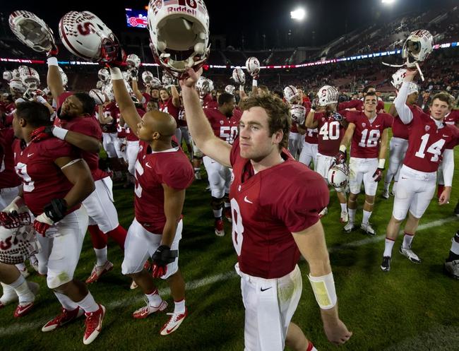 Nov 30, 2013; Stanford, CA, USA; Stanford Cardinal quarterback Kevin Hogan (8) celebrates after Stanford defeated the Notre Dame Fighting Irish 27-20 at Stanford Stadium. Mandatory Credit: Matt Cashore-USA TODAY Sports
