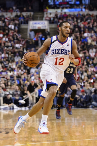 Nov 29, 2013; Philadelphia, PA, USA; Philadelphia 76ers guard Evan Turner (12) during the third quarter against the New Orleans Pelicans at the Wells Fargo Center. The Pelicans defeated the Sixers 121-105. Mandatory Credit: Howard Smith-USA TODAY Sports