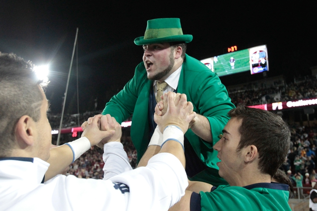 Nov 30, 2013; Stanford, CA, USA; Notre Dame Fighting Irish mascot does push ups held up by the male cheerleaders after a play against the Stanford Cardinal during the third quarter at Stanford Stadium. The Stanford Cardinal defeated the Notre Dame Fighting Irish 27-20. Mandatory Credit: Kelley L Cox-USA TODAY Sports