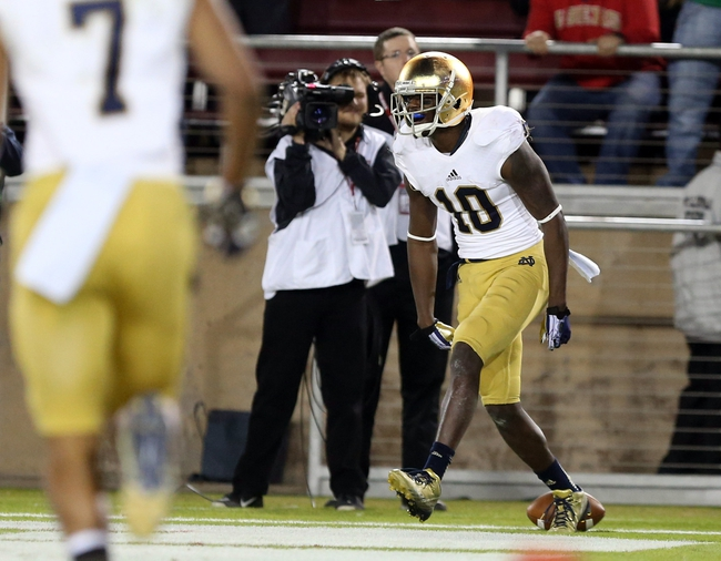 Nov 30, 2013; Stanford, CA, USA; Notre Dame Fighting Irish wide receiver DaVaris Daniels (10) celebrates after a touchdown against the Stanford Cardinal during the third quarter at Stanford Stadium. The Stanford Cardinal defeated the Notre Dame Fighting Irish 27-20. Mandatory Credit: Kelley L Cox-USA TODAY Sports