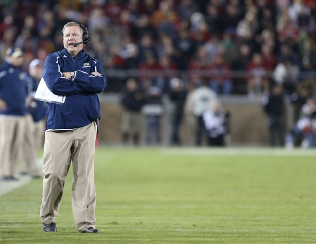 Nov 30, 2013; Stanford, CA, USA; Notre Dame Fighting Irish head coach Brian Kelly on the field against the Stanford Cardinal during the fourth quarter at Stanford Stadium. The Stanford Cardinal defeated the Notre Dame Fighting Irish 27-20. Mandatory Credit: Kelley L Cox-USA TODAY Sports