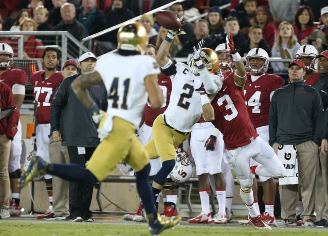 Nov 30, 2013; Stanford, CA, USA; Notre Dame Fighting Irish cornerback Bennett Jackson (2) intercepts the pass intended for Stanford Cardinal wide receiver Michael Rector (3) during the fourth quarter at Stanford Stadium. The Stanford Cardinal defeated the Notre Dame Fighting Irish 27-20. Mandatory Credit: Kelley L Cox-USA TODAY Sports