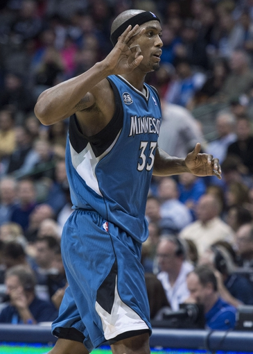 Nov 30, 2013; Dallas, TX, USA; Minnesota Timberwolves power forward Dante Cunningham (33) celebrates making a three point basket against the Dallas Mavericks during the second half at the American Airlines Center. The Timberwolves defeated the Mavericks 112-106. Mandatory Credit: Jerome Miron-USA TODAY Sports