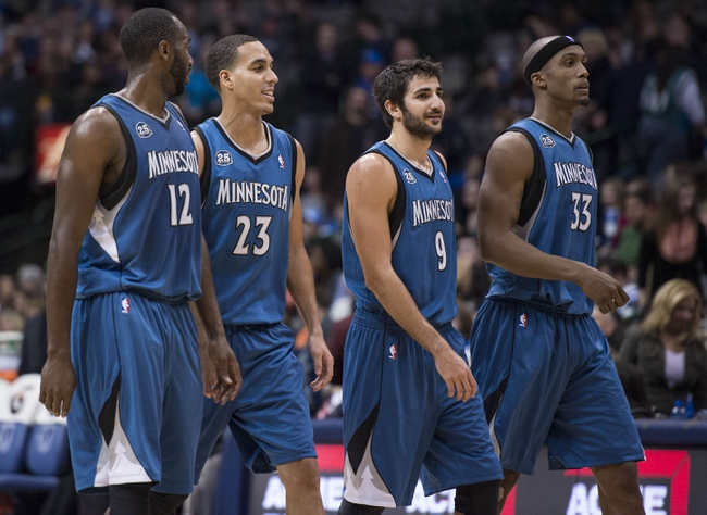 Nov 30, 2013; Dallas, TX, USA; Minnesota Timberwolves power forward Luc Richard Mbah a Moute (12) and shooting guard Kevin Martin (23) and point guard Ricky Rubio (9) and power forward Dante Cunningham (33) come off the court during the second half against the Dallas Mavericks at the American Airlines Center. The Timberwolves defeated the Mavericks 112-106. Mandatory Credit: Jerome Miron-USA TODAY Sports
