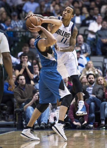 Nov 30, 2013; Dallas, TX, USA; Dallas Mavericks shooting guard Monta Ellis (11) is called for the could on Minnesota Timberwolves point guard Ricky Rubio (9) during the second half at the American Airlines Center. The Timberwolves defeated the Mavericks 112-106. Mandatory Credit: Jerome Miron-USA TODAY Sports