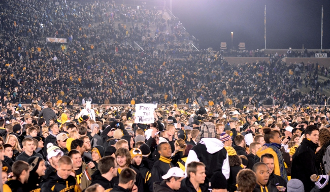 Nov 30, 2013; Columbia, MO, USA; Missouri Tigers students and fans storm the field after the game against the Texas A&M Aggies at Faurot Field. Missouri win 28-21. Mandatory Credit: Denny Medley-USA TODAY Sports