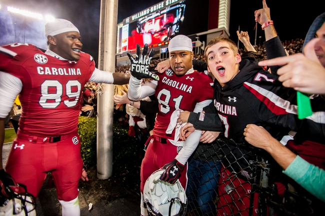 Nov 30, 2013; Columbia, SC, USA; South Carolina Gamecocks tight end Jerell Adams (89) and South Carolina Gamecocks wide receiver Kwinton Smith (82) celebrate with fans following their 31-17 win over the Clemson Tigers at Williams-Brice Stadium. Mandatory Credit: Jeff Blake-USA TODAY Sports