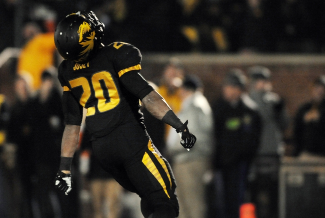 Nov 30, 2013; Columbia, MO, USA; Missouri Tigers running back Henry Josey (20) celebrates after scoring  during the second half of the game against the Texas A&M Aggies at Faurot Field. Missouri win 28-21. Mandatory Credit: Denny Medley-USA TODAY Sports