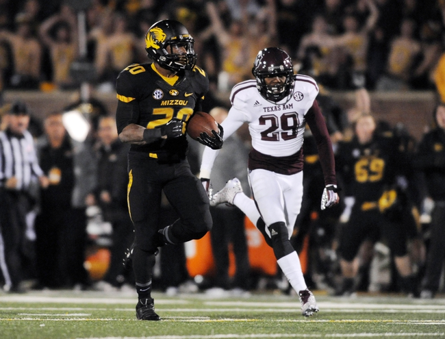 Nov 30, 2013; Columbia, MO, USA; Missouri Tigers running back Henry Josey (20) runs in for a touchdown as Texas A&M Aggies defensive back Deshazor Everett (29) chases during the second half of the game at Faurot Field. Missouri win 28-21. Mandatory Credit: Denny Medley-USA TODAY Sports