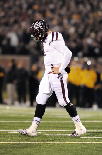 Nov 30, 2013; Columbia, MO, USA;  Texas A&M Aggies quarterback Johnny Manziel (2) walks off the field after a turnover on downs during the second half of the game against the Missouri Tigers at Faurot Field. Missouri win 28-21. Mandatory Credit: Denny Medley-USA TODAY Sports