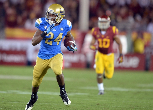 Nov 30, 2013; Los Angeles, CA, USA; UCLA Bruins running back Paul Perkins (24) carries the ball against the Southern California Trojans at Los Angeles Memorial Coliseum. Mandatory Credit: Kirby Lee-USA TODAY Sports