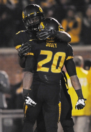 Nov 30, 2013; Columbia, MO, USA; Missouri Tigers running back Henry Josey (20) is congratulated by wide receiver Dorial Green-Beckham (15) after a touchdown during the second half of the game against the Texas A&M Aggies at Faurot Field. Missouri win 28-21. Mandatory Credit: Denny Medley-USA TODAY Sports
